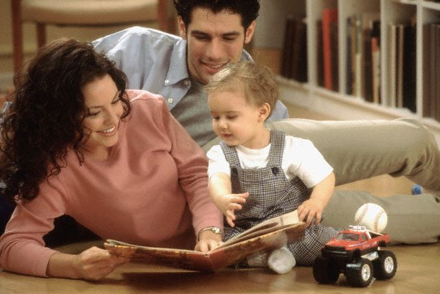 01 Jan 2000 --- Showing baby a book --- Image by © Jose Luis Pelaez, Inc./CORBIS