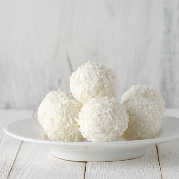 Coconut candies pile in white plate
