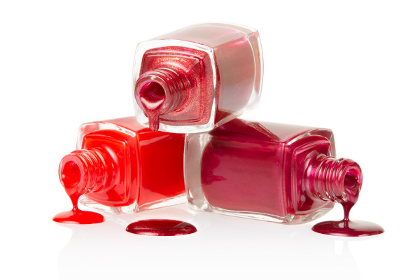 Red nail polish spilled isolated on white background, clipping path included