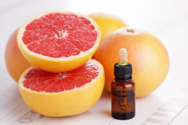 bottle of grapefruit essential oil - beauty treatment