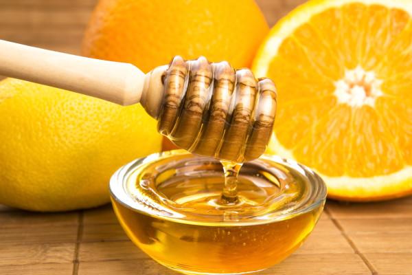 fresh honey with lemon and orange fruits