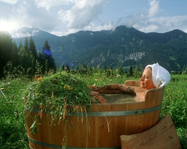 Woman in hay bath