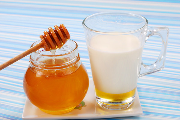 milk with honey in glass as natural medicine